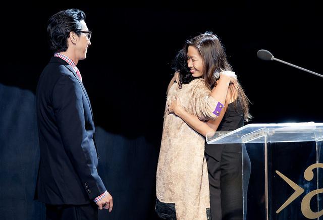 Christina Chiu passing her prize to next winners A4 Gala